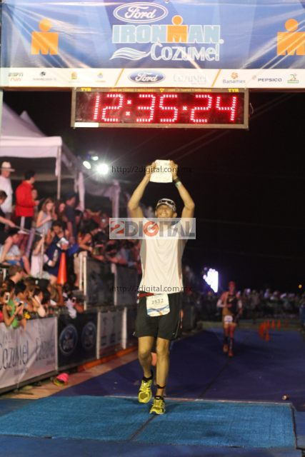 J crossing the finish line, beating his last Ironman finish time by 1 hour!